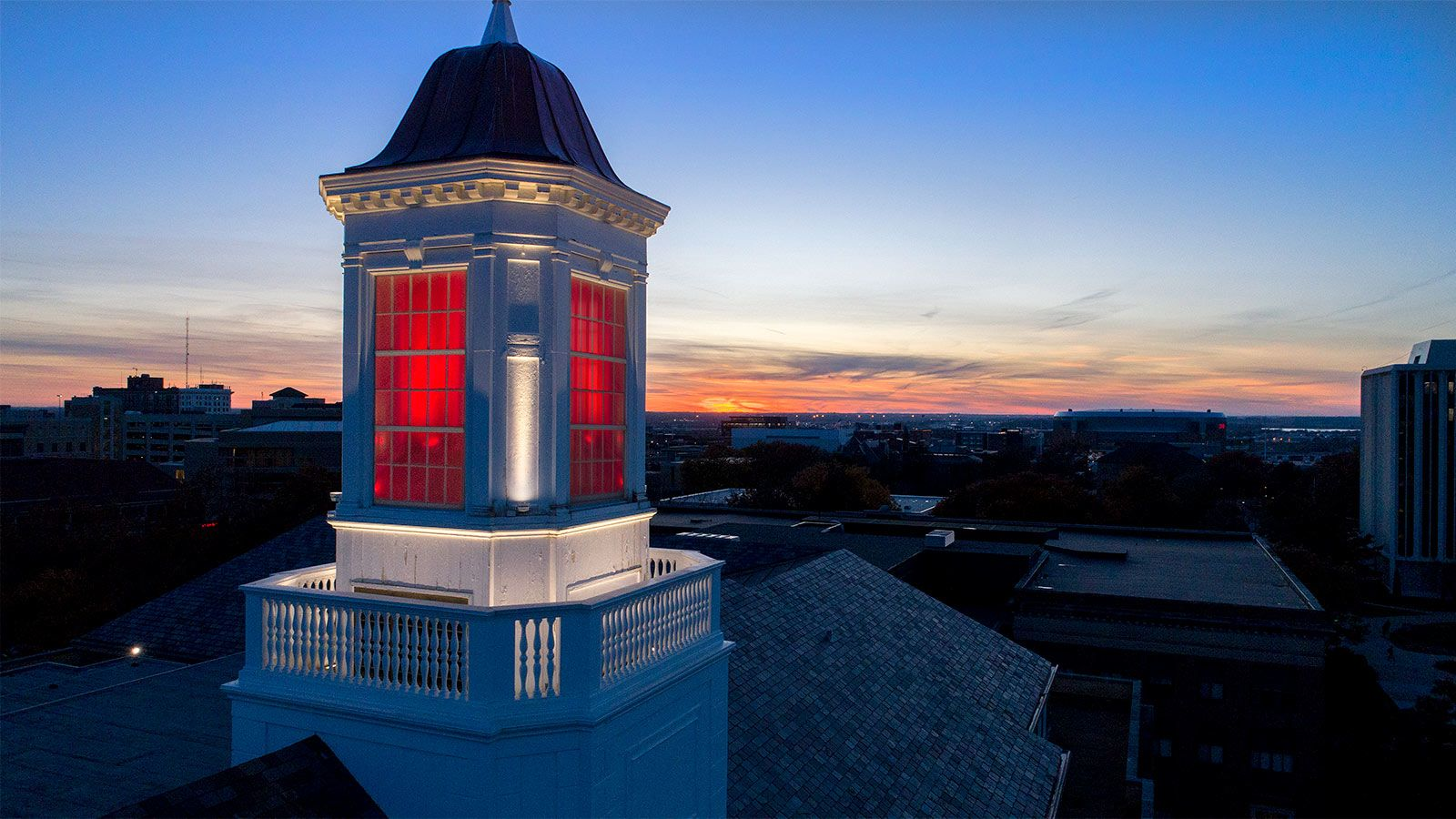The cupola on top of Love Library lit up red