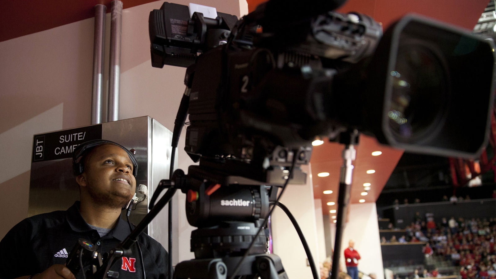 Journalism student films a football game